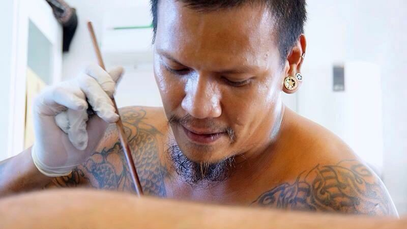 Bamboo tattoo, hygienic tattoos and gloves.