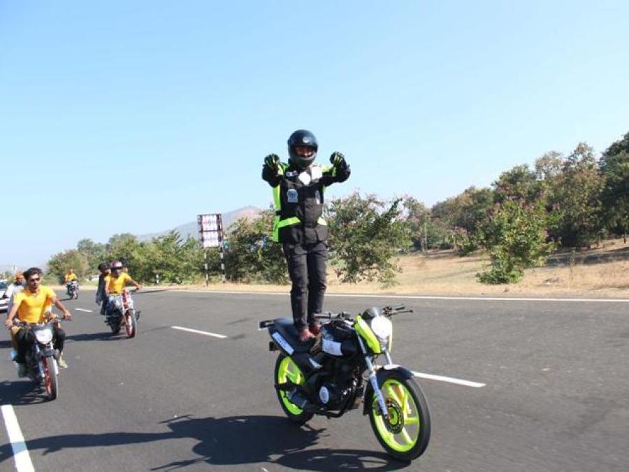 Performing Christ Bike Stunt