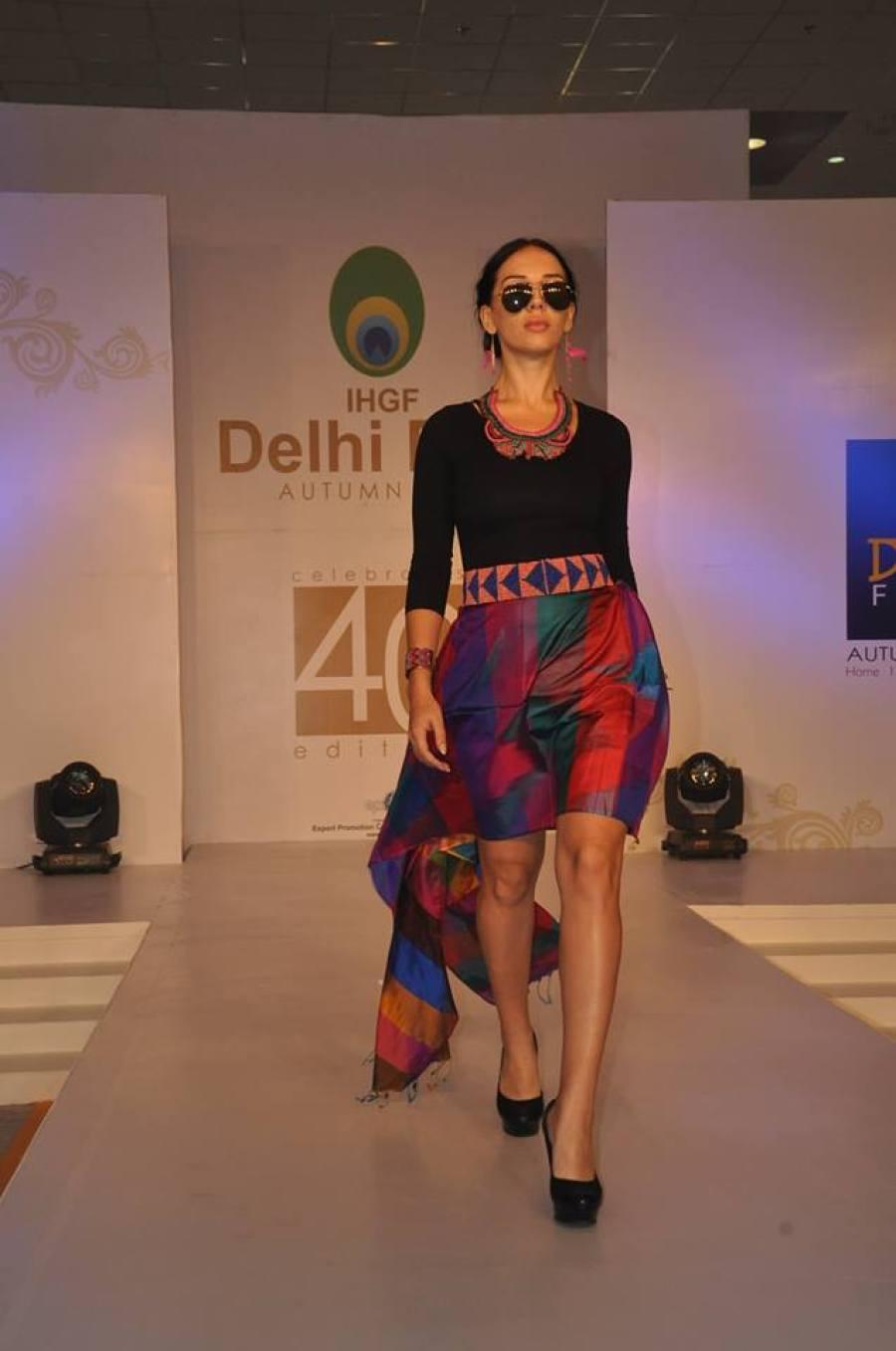 Model walking the ramp in Neetu's designs