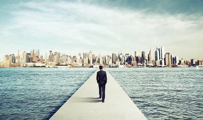 man walking into city - small