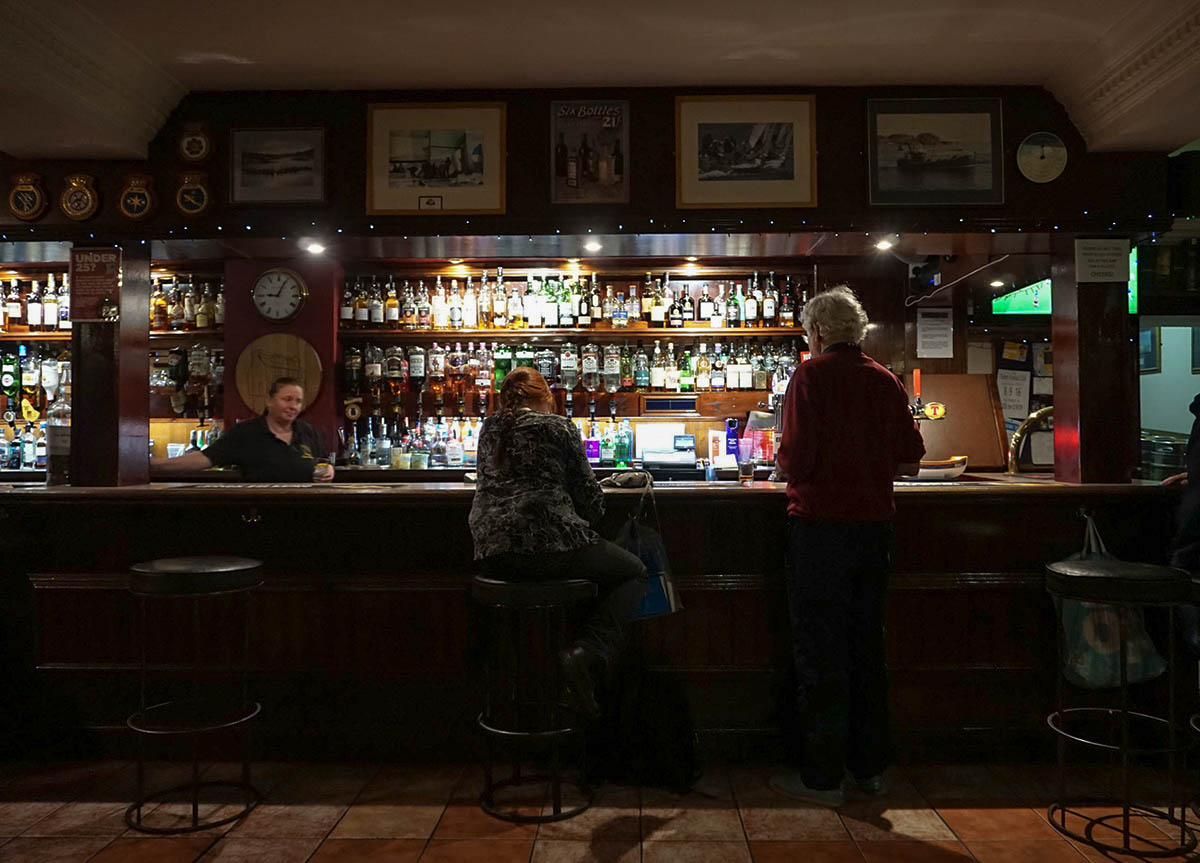 Corner House Bar in Tarbert. Whisky Selection in a Traditional Scottish Fishing Village