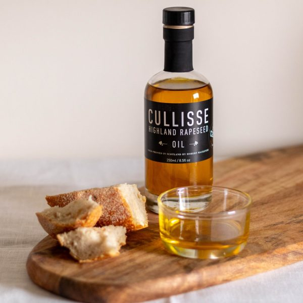 Cullisse Rapeseed oil with bread on wooden board