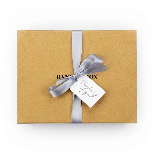 Banilla Box with Grey Ribbon and swing tag saying thinking of you