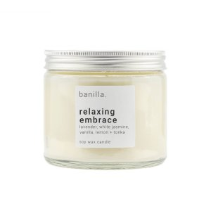 Relaxing embrace candle in clear jar