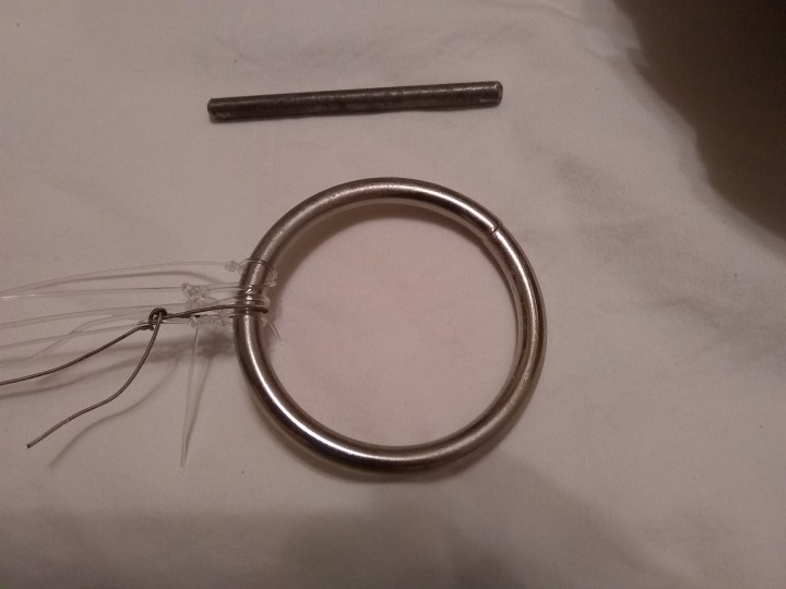 A steel ring and a piece of quarter inch round steel