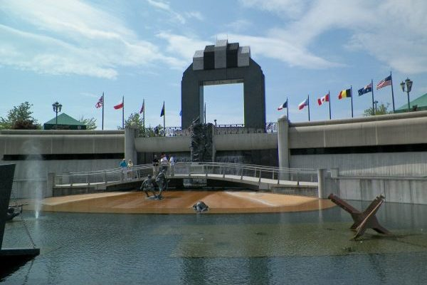Bedford, VA Insurance Agency, nearby National D Day Memorial bronze statues of soldiers emerging from water memorializing D-Day invasion.