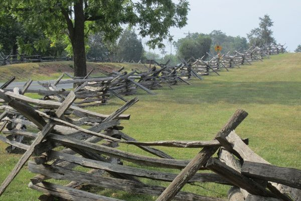 Fairfax, VA Manassas Battlefield, long line of split rail fence surrounding green battlefield lawns.