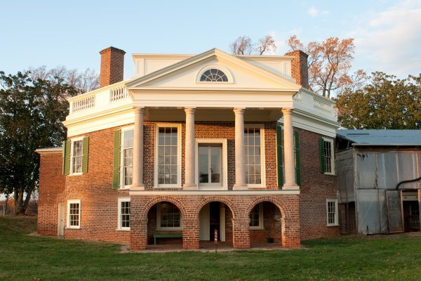 Lynchburg, VA Thomas Jefferson's Poplar Forest, two story red brick octagon-shaped house with four white pillars forming entry portico.