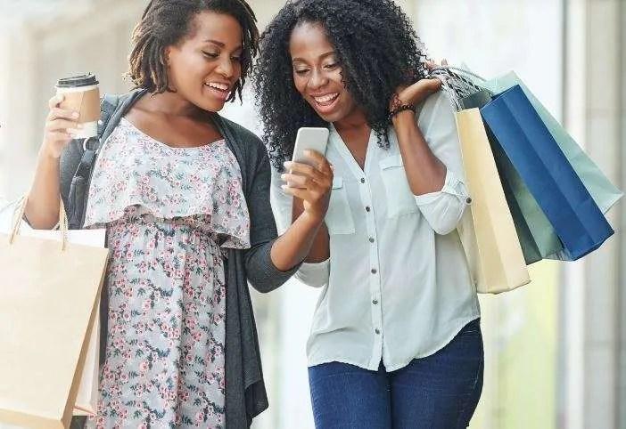 Fidelity-Bank-green-rewards-loyalty-scheme-women-laugh