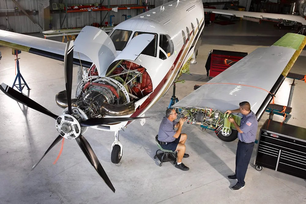 Technicians working on Pilatus