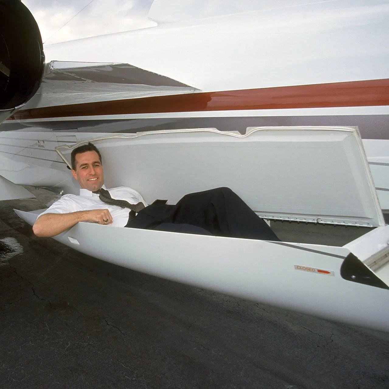 Pilot laying in Raisbeck aft fuselage locker