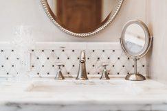 Custom tile backsplash in a bathroom.