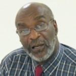 NUPW General Secretary Denis Clarke