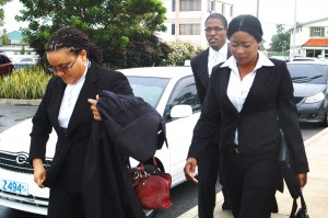 Flashback: Shanique Myrie and her attorneys on the way to court in Barbados last year.