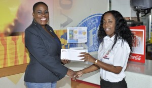 KFC Marketing Coordinator, Shekelia Barrow, presented Donnah Russell, Executive Director of the Variety Club with proceeds from the sale of Gold Hearts in KFC restaurants.