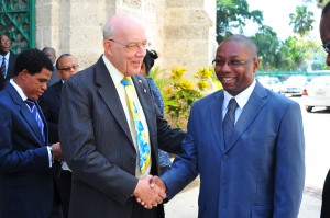 Professor Henry Fraser shares a light moment with Andre Worrell.