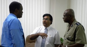 Talking Cash-For-Gold: Commissioner of Police, Darwin Dottin (right) with his Acting ACP for Territorial Policing, Erwin Boyce (left) and President of the Barbados Chamber of Commerce and Industry, Lalu Vaswani today. (EJ)