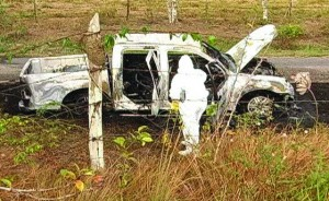 Burnt-out pick-up truck at crime scene.