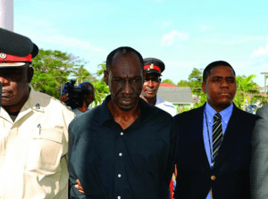 Primary school teacher Ruddy Charlton (centre) was arraigned on Tuesday on bigamy charges.