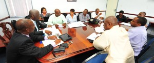 Ministers Stephen Lashley (left) and Ronald Jones (second left) during today's meeting with sports and schools officials.