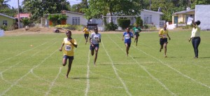 There is no catching Ellerton Primary's Lashonte Roberts (left) in her 200m heat for age 12-15 girls.