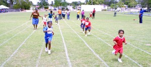Little Chloe Gill (right) of Sunshine Stimulation Centre running to victory in the 25m.