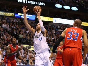 Dallas Mavericks' forward Dirk Nowitzki (with ball) had a season best 33 points against the Clippers.