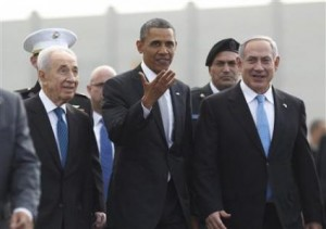 US President Barack Obama (centre) participates in a farewell ceremony with Israeli Prime Minister Benjamin Netanyahu (right) and President Shimon Peres (left) at Tel Aviv International Airport today.