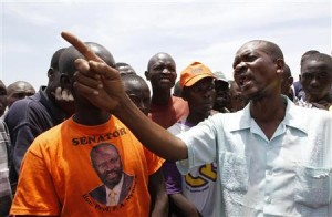 People discuss the presidential elections results in Kisumu