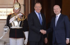Britain's Foreign Secretary William Hague (R) shakes hands with Russian Foreign Minister Sergei Lavrov in London today.