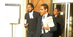 Attorney David Comission (centre) leading the team leaving the court after the hearing.