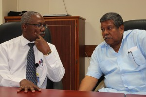 Hospital director David Callender (left) chats with PAHO's Dr. Ernest Pate.