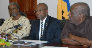 Minister of Culture, Sports and Youth, Stephen Lashley, said that reparations remain a burning issue for descendants of African slaves, while Acting Director of the Commission for the Pan African Affairs, Dr. Deryck Murray (left) and Acting Permanent Secretary for the Ministry of Culture, Sports and Youth, Esworth Reid look on.