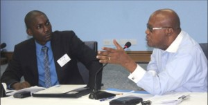 PS Lionel Weekes gesticulates as he makes a point to the stakeholders, while National Coordinator of the GEF SGP, David Bynoe looks on.