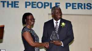 The BUT's Jacqueline Sealy presented Prime Minister Freundel Stuart with a token.