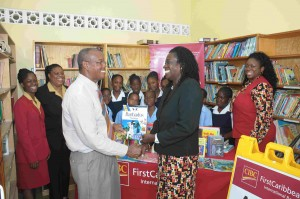 Principal of Roland Edwards Primary School in Barbados, Michael Watson (left) and his students were pleased to receive over 80 books for the school's library from staff at the Speightstown branch, led by Branch Manager, Cheryl Stoute.
