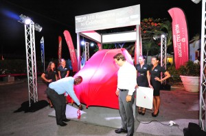 Minister Donville Inniss prepares to unveil grand prize.