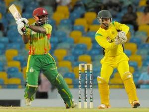 Devon Smith (left) batting the Windward Islands to victory last night. The wicketkeeper is Carlton Baugh Jr.