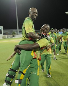 Opener Devon Smith (being lifted) won the Sir Vivian Richards award.
