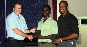 Corey Greaves (centre) and Andre Lovell collect their awards. Absent is Nigel Wallace.