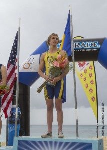 Jason Wilson stands proudly on the podium.