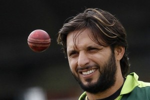 Pakistan's captain Afridi eyes a ball during a training session before their first cricket test match against Australia at Lord's cricket ground in London
