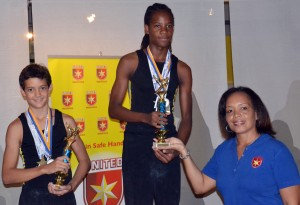 Rivalry was great in the boys' Level 6 division between Teriq Linton (centre) and Brandon Gill (left). Linton emerged all-around winner and accepted his trophy from Trudy Bellamy.