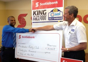 Scotia's Victor Bynoe (left) shakes hands with the Barbados Rally Club's Mark Hamilton.