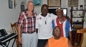 Briand with Kerwin Delpeche, his father Randolph and Captain Dennis Griffith.