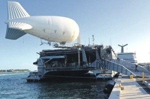 A balloon-like craft known as an aerostat is shown attached to the back of the US Navy high-speed vessel Swift docked in Key West.
