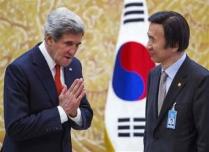 US Secretary of State John Kerry (left) greets South Korea's Foreign Minister Yun Byung-se in Seoul today.