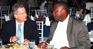 Andy Armstrong (left) and Minister Donville Inniss.