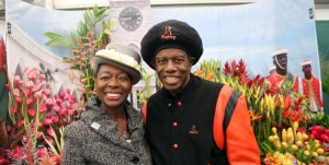 International singer and Barbados resident Eddy Grant poses with Baroness Floella Benjamin in front of the B'dos display.
