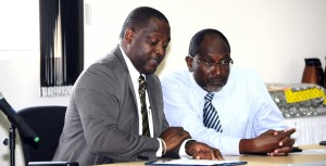 Minister of Industry Donville Inniss and Dr. Leroy McClean of BIDC.